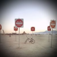 Bike on Playa inside Traffic Signs